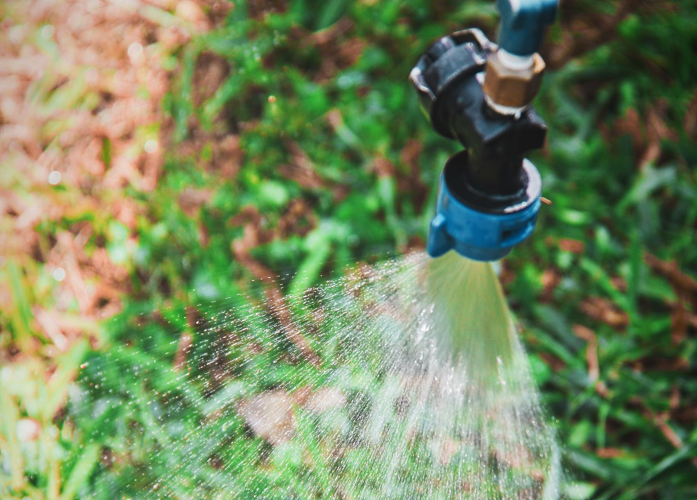 """(source: <a href=""""https://flic.kr/p/hKwMX1"""">Pesticide spraying - Photo by Sharon Dowdy</a>)"""